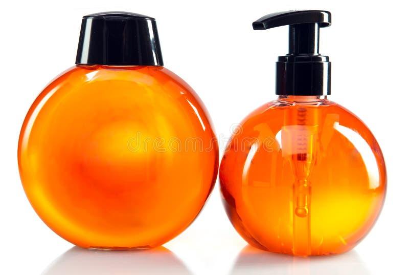 Małe butelki kosmetyczne z aptekarką fotografia royalty free