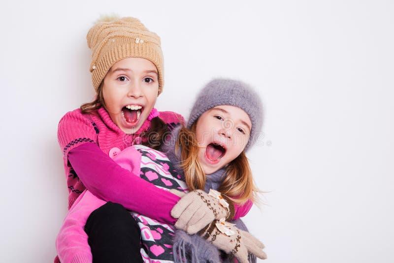 Małe dziewczynki żartują zdziwionego obraz stock