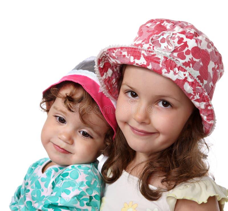 małe siostry dwa zdjęcia royalty free