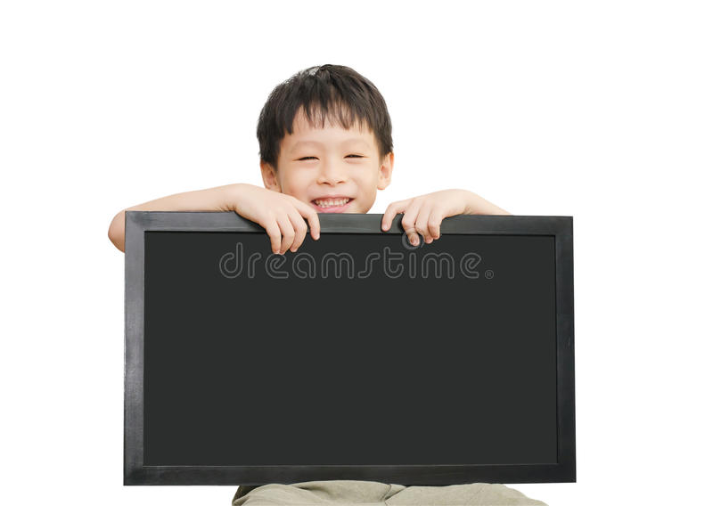 Małego Azjatyckiego chłopiec mienia pusty chalkboard zdjęcie stock