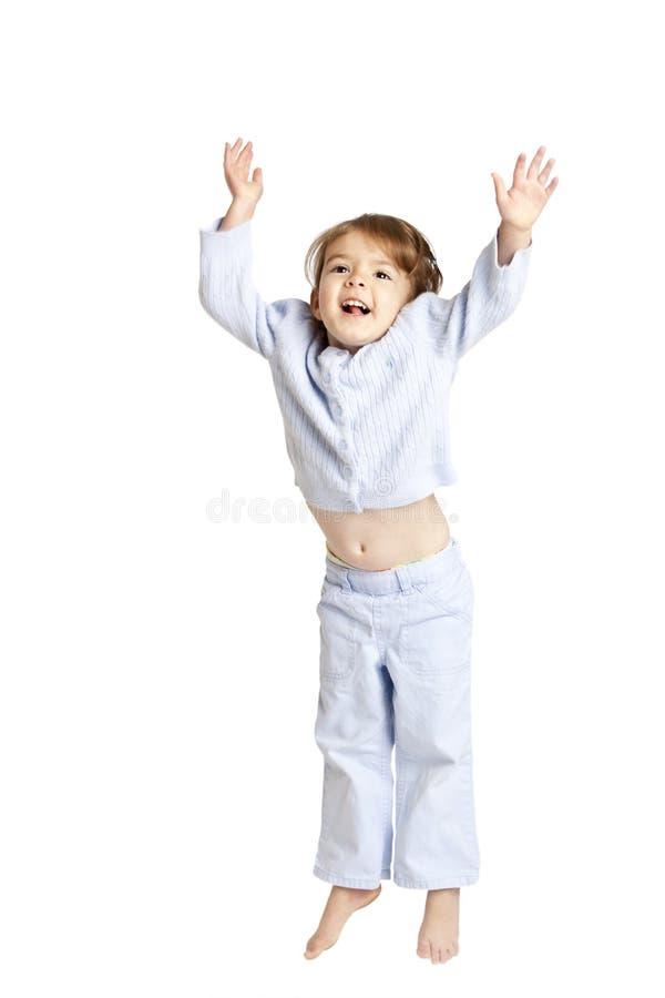 Małej dziewczynki doskakiwanie, ścinek ścieżka zdjęcia stock