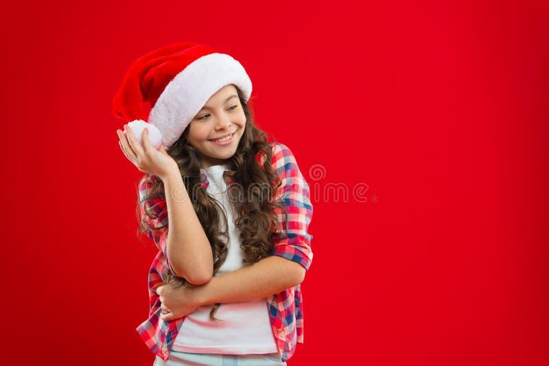 Małej dziewczynki dziecko w Santa kapeluszu bożych narodzeń target952_1_ wakacje szczęśliwa zima mała dziewczynka Teraźniejszość  fotografia royalty free