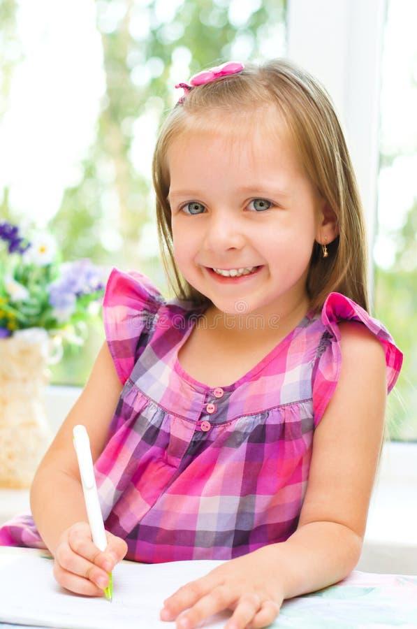 Małej dziewczynki writing zdjęcie royalty free
