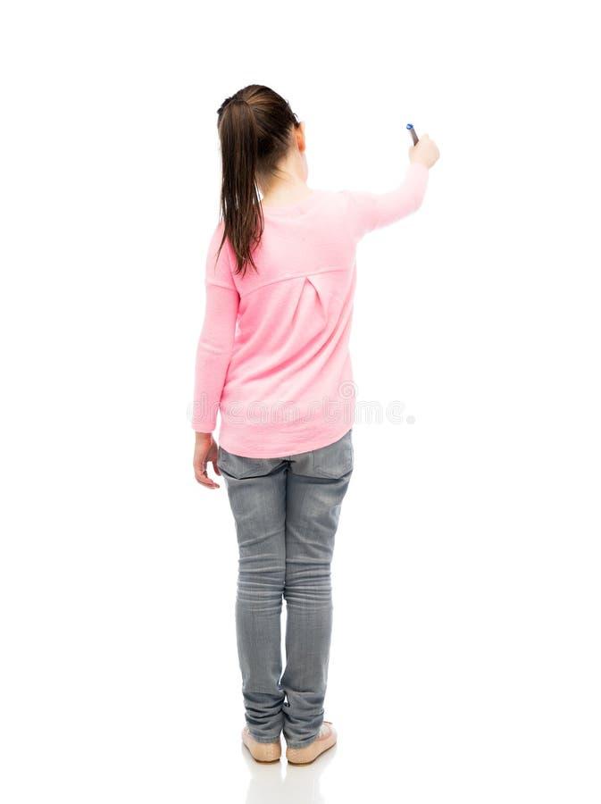 Małej dziewczynki writing z markierem lub rysunek obraz royalty free