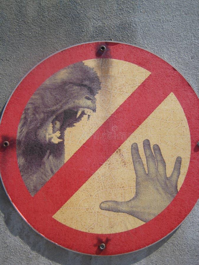 Małpi kąska znak ostrzegawczy fotografia stock