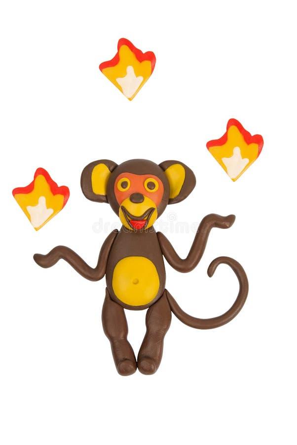 Małpi rzutu ogień _ plastelina zdjęcie royalty free