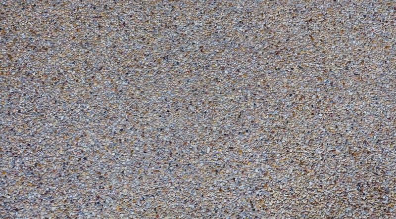 Mały żwir na betonowym tekstury tle fotografia royalty free