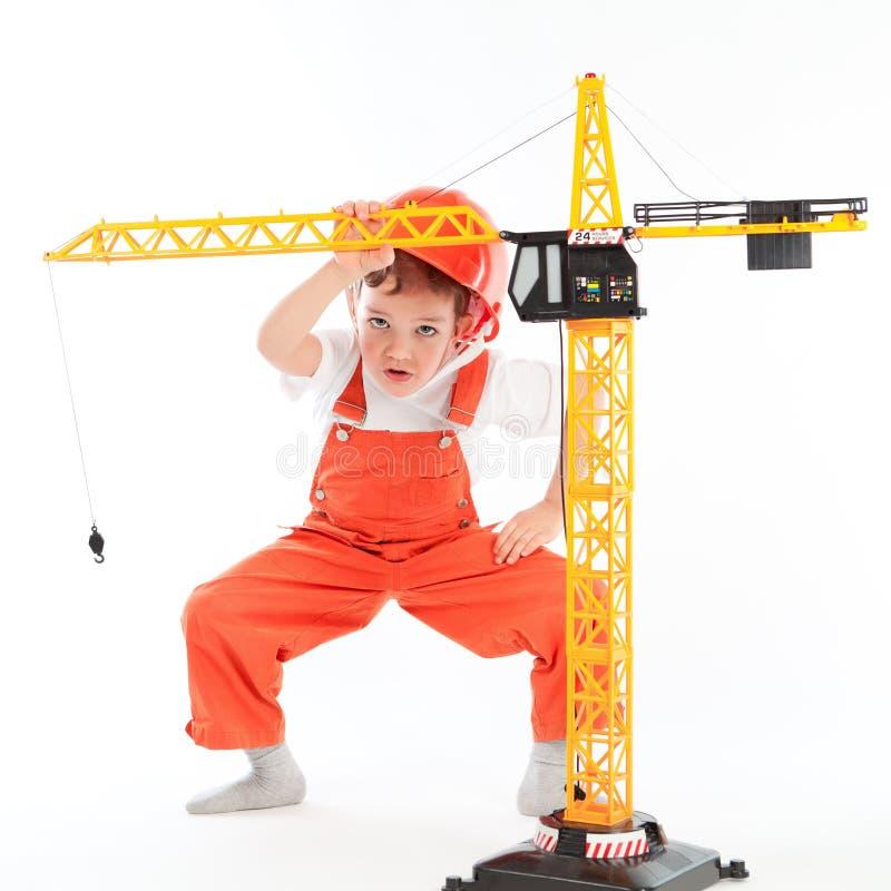Download Mały Budowniczy I żuraw Na Białym Tle Obraz Stock - Obraz złożonej z profesjonalista, ląg: 28970021