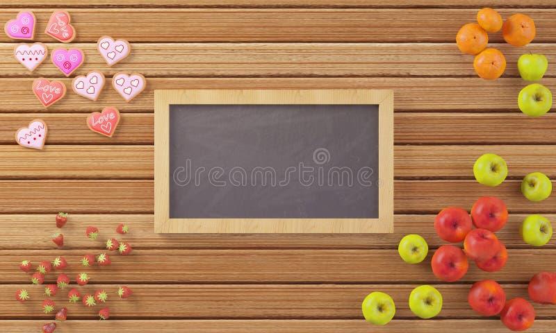 Mały chalkboard otaczający owoc i ciastkami fotografia stock