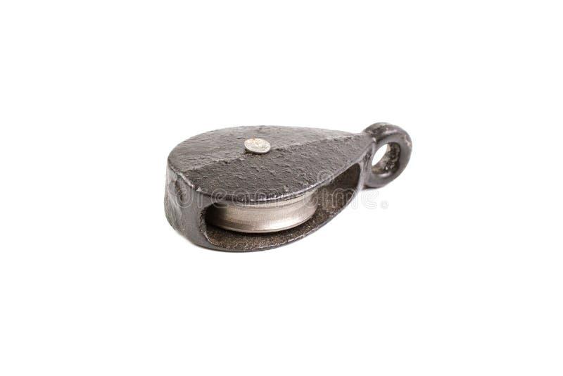 Mały czarny stalowy pulley na białym tle fotografia stock