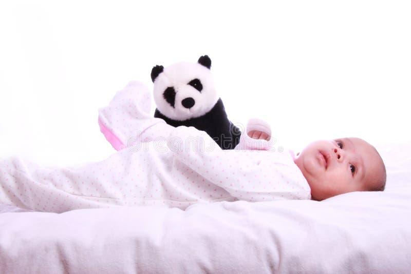 Mały dziecko bawić się z miękkiej części zabawką obrazy royalty free