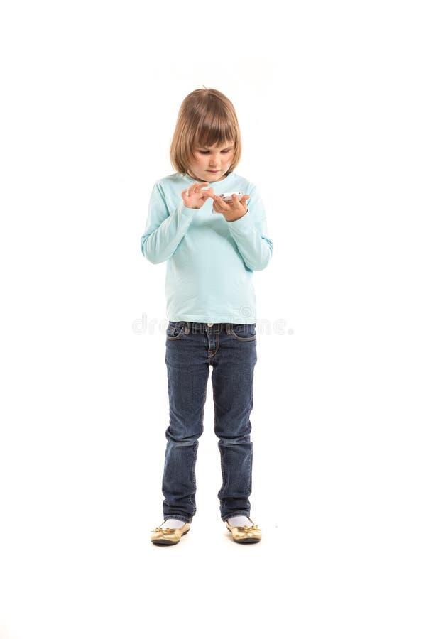 mały dziewczyny smartphone obraz stock