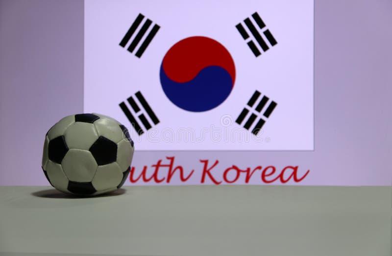 Mały futbol na białej podłoga i Poludniowo-koreański naród zaznaczamy z tekstem Południowego Korea tło zdjęcie royalty free