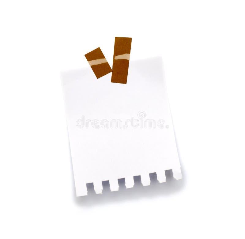 Mały kawałek papieru trzymający adhezyjnym obraz royalty free