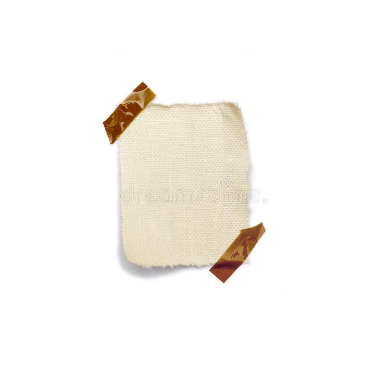 Mały kawałek papieru trzymający adhezyjnym obrazy royalty free