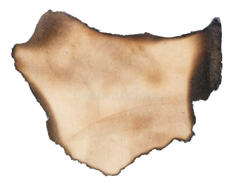 Mały kawałek yellowed papier z przypalać czarnymi krawędziami zdjęcie royalty free