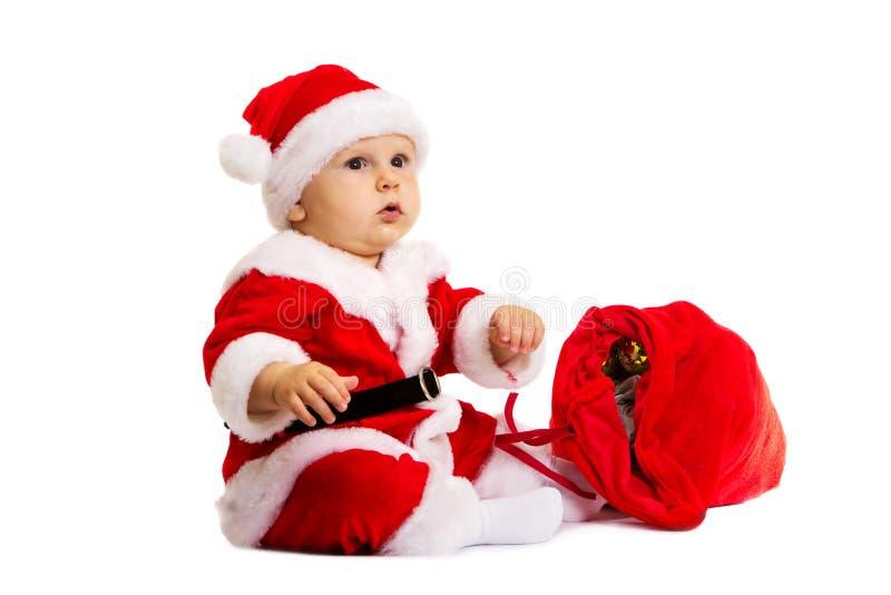 Mały Santa z czerwoną torbą dla prezentów zbliżać on zdjęcie stock