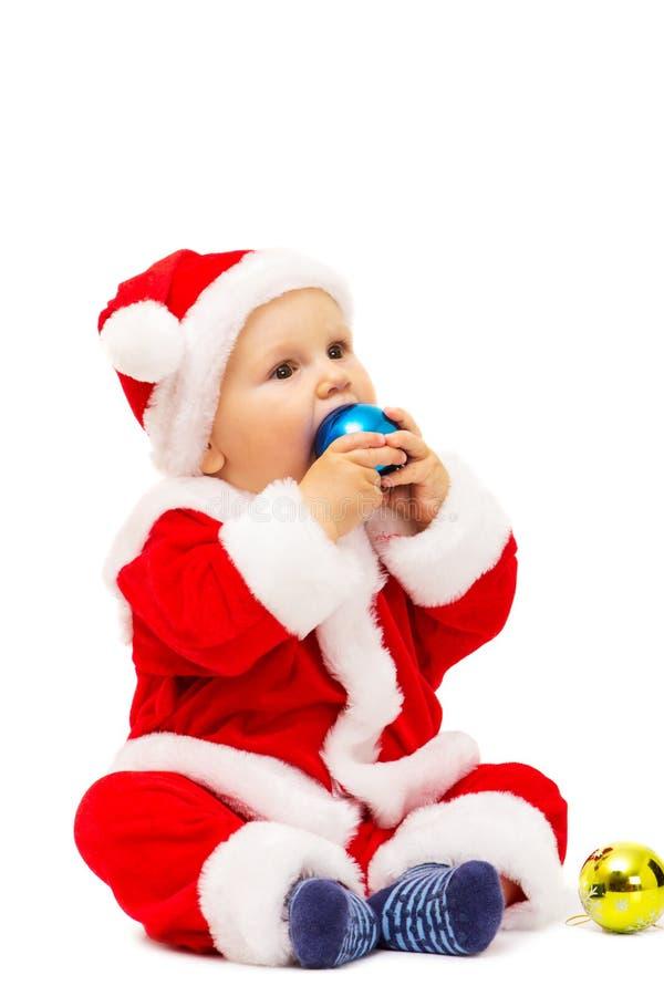 Mały Santa z zabawkami i sferami w rękach obraz royalty free