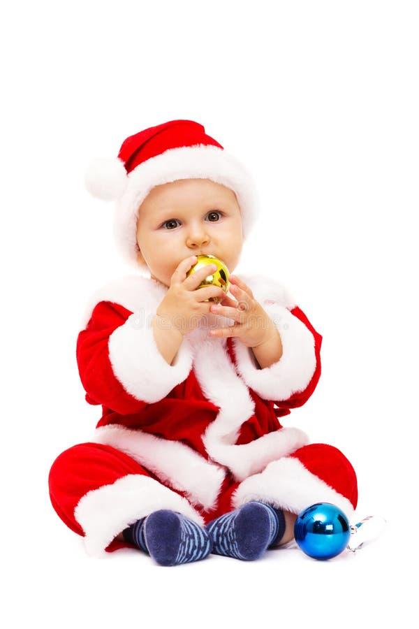 Mały Santa z zabawkami i sferami w rękach zdjęcia stock