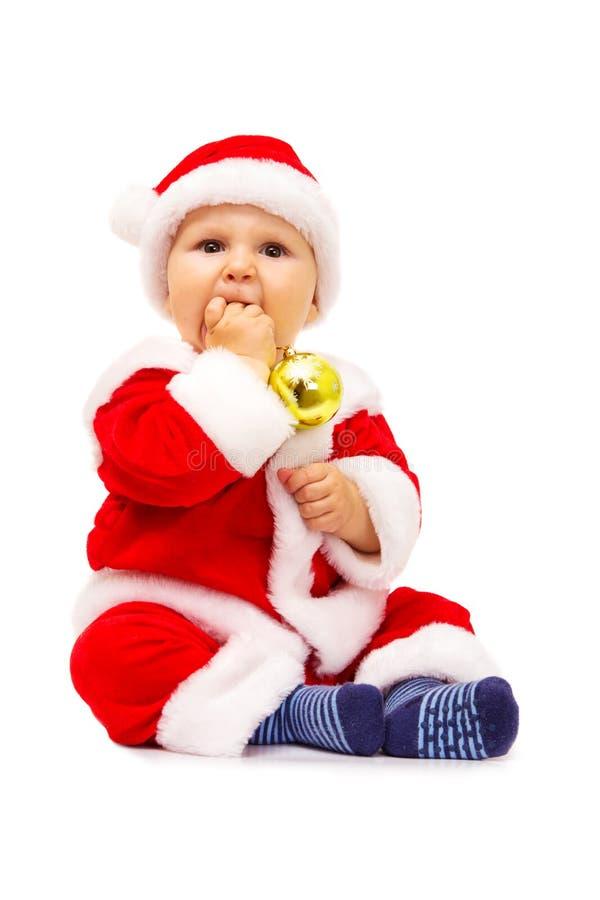 Mały Santa z zabawkami i sferami w rękach zdjęcia royalty free