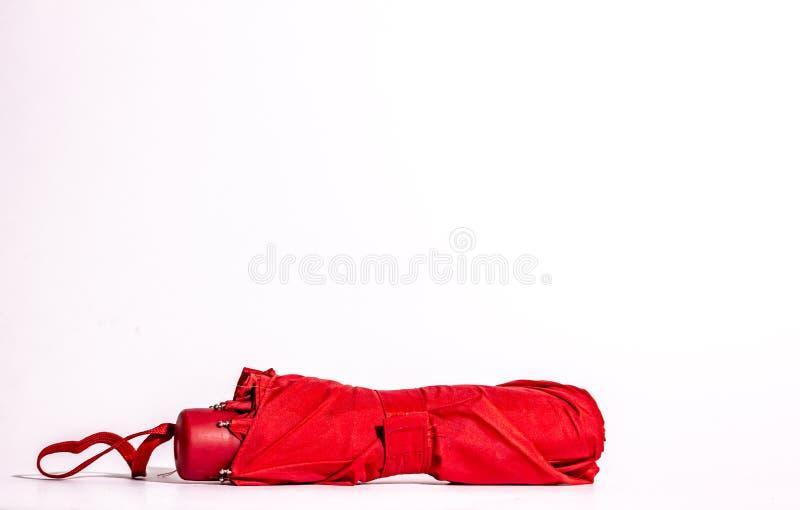 mały, składany, czerwony, zamknięty parasol obraz stock