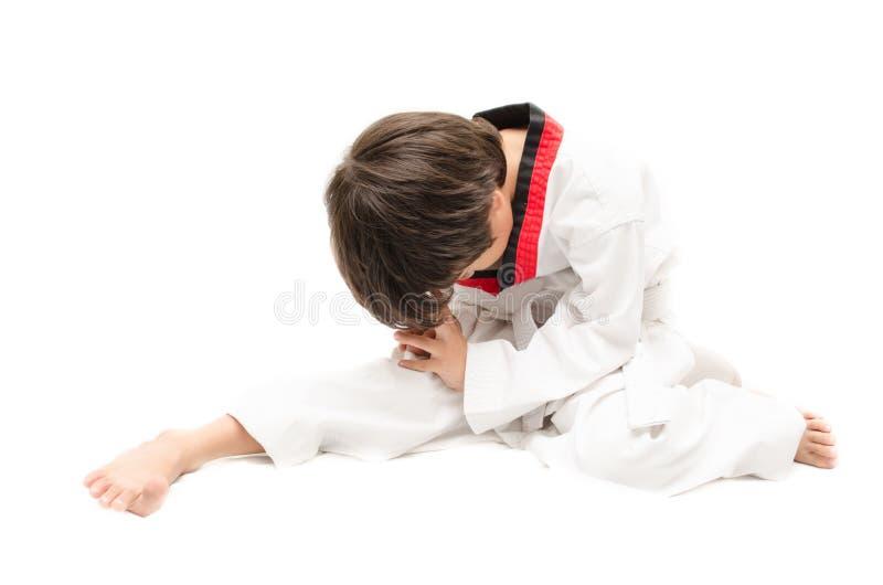 Mały tae kwon robi chłopiec sztuce samoobrony grzać up obrazy royalty free