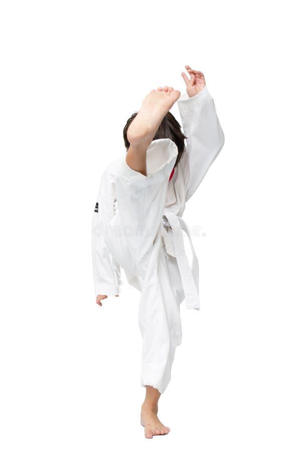 Mały tae kwon robi chłopiec sztuce samoobrony na białym tle obraz stock