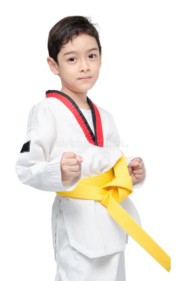 Mały tae kwon robi chłopiec sztuki samoobrony koloru żółtego paskowi obrazy stock