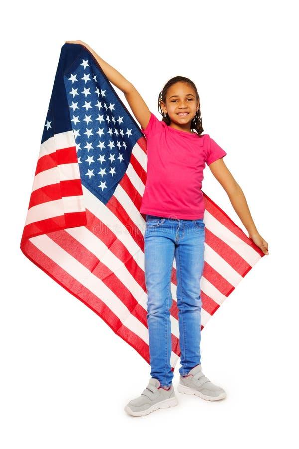 Mały usa patriota dumnie trzyma dużego sztandar zdjęcia stock