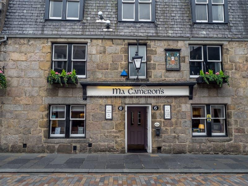 Ma Cameron`s pub, Aberdeen. ABERDEEN, SCOTLAND: JULY 23: Exterior facade of the Ma Cameron`s pub in the evening on July 23, 2017 in Aberdeen, Scotland. The Ma royalty free stock photos