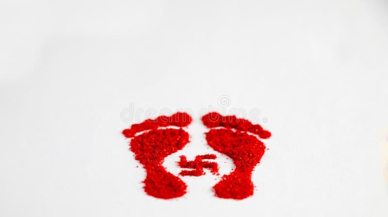 Maa Lakshmi footprint made by red rangoli. Diwali india royalty free stock photo