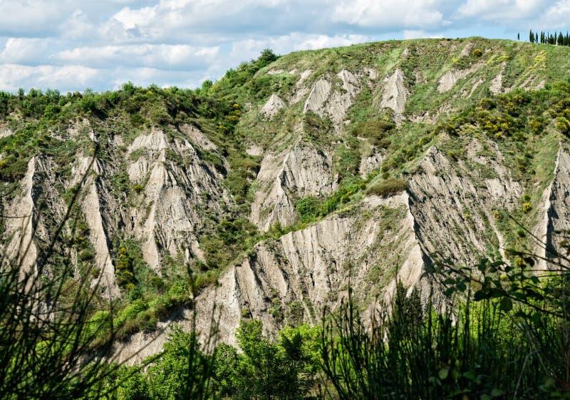 Maan als landschap van senesi van Kreta in Toscanië stock afbeelding