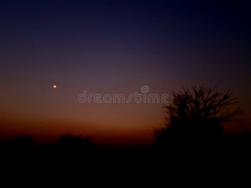 Maan bij Zonsondergang royalty-vrije stock foto