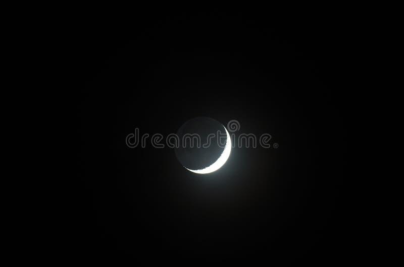 Maan met earthshine stock fotografie