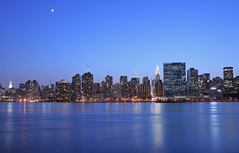Maanlicht over Manhattan stock foto's