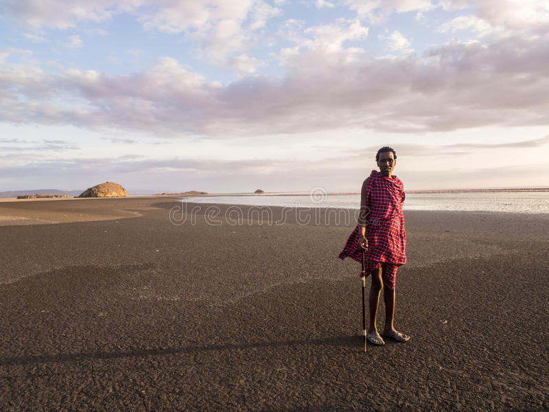 Maasai in Arusha. Maasai guide leading tourists to visit Lake Natron in the north of Tanzania, Africa, at sunset stock photos