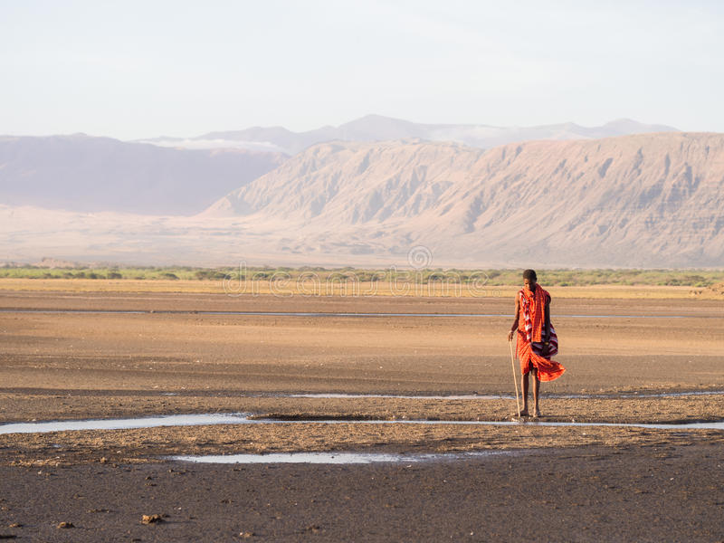 Maasai in Arusha. Maasai warrior wearing traditional red clothes in the dried part of Lake Natron in the North of Tanzania, Africa stock photos
