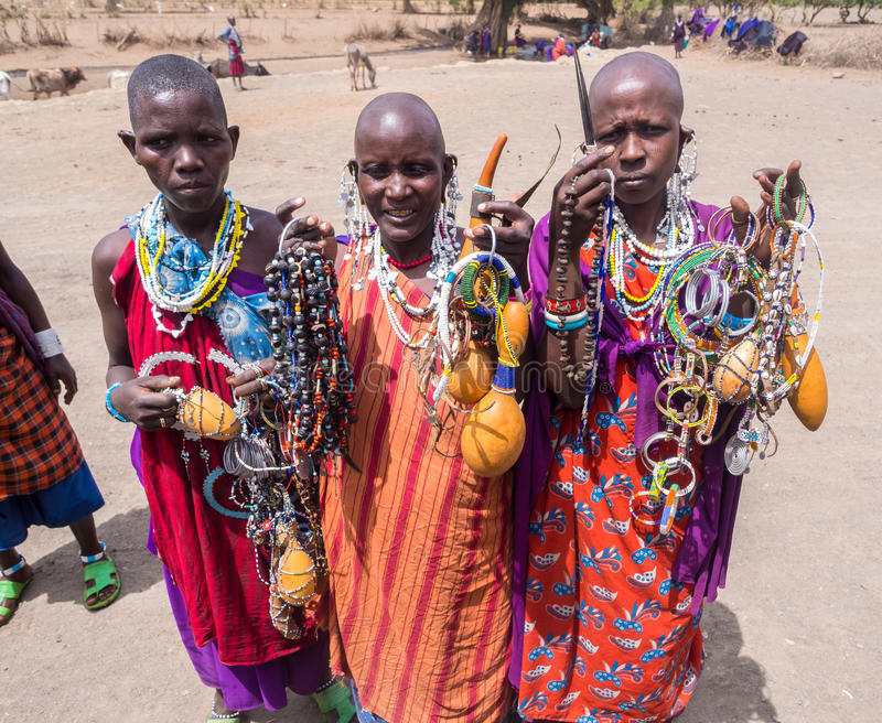 Maasai in Arusha. Maasai women offering souvenirs (mainly traditional jewelry) to the tourists in Arusha region, Tanzania, Africa stock images