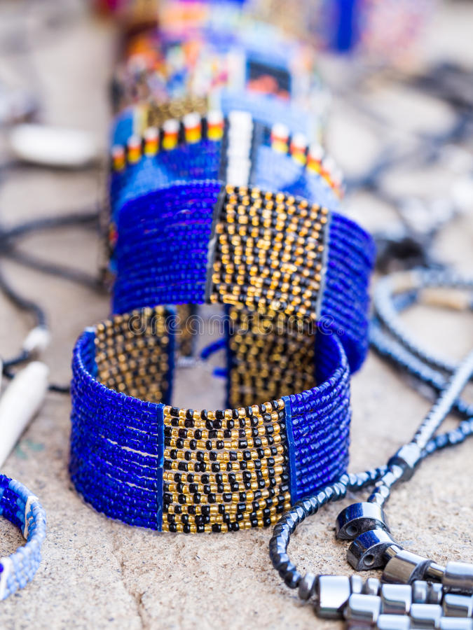 Maasai jewelry. Maasai baracelet and other jewelry sold as souvenirs in Arusha Region, Tanzania, Africa stock photography