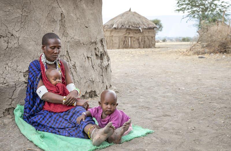 Beautiful maasai woman with a kid stock images