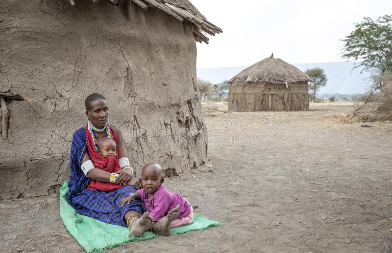 Maasai lady resting with her kid stock photos