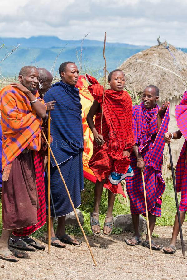 Maasai men performing tradition Masai jumping dance at village in Arusha, Tanzania, East Africa stock image