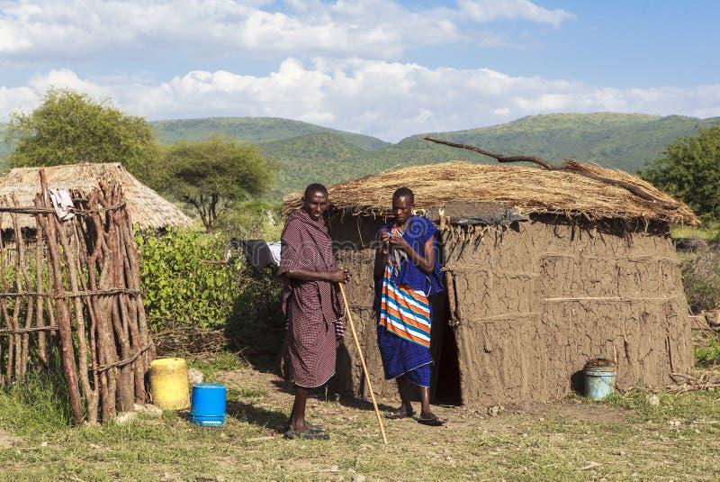 MAASAI PEOPLE IN MASAI MARA PARK, KENYA. This photo was taken on Feb, 2016 in Masai Mara National Park, Kenya. The Maasai are a Nilotic ethnic group of semi stock photography