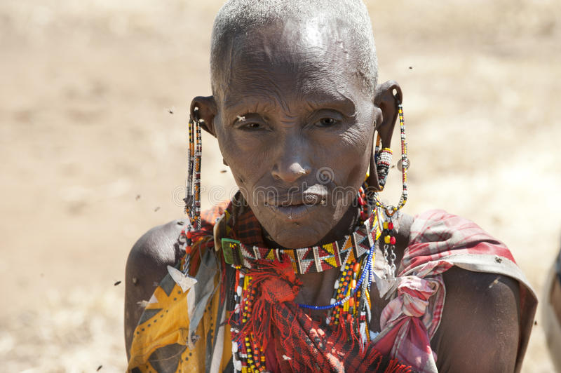 Masai woman with typical ear decoration and traditional beadworks, Tanzania, Africa royalty free stock photo