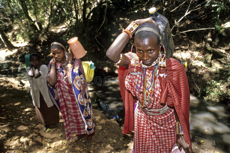 Maasai women have fetched water in small stream royalty free stock image