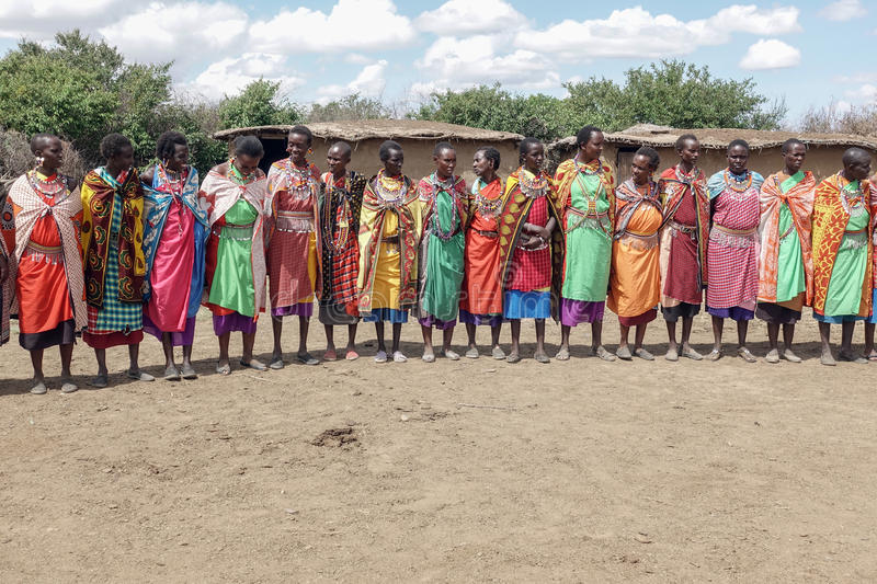 Maasai women sing the welcome song for tourists who visit Masai stock photos
