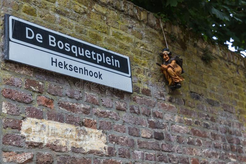 Streetname sign in Maastricht Dialect heksenhook = witch corner stock photography
