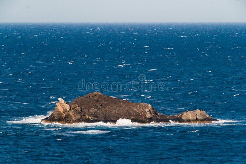 Maca Oros island in Cap de Creus national park, Mediterranean sea coast in Costa Brava, Spain. The wind beaten and dry rocky landscape of Maca Oros island in the royalty free stock image