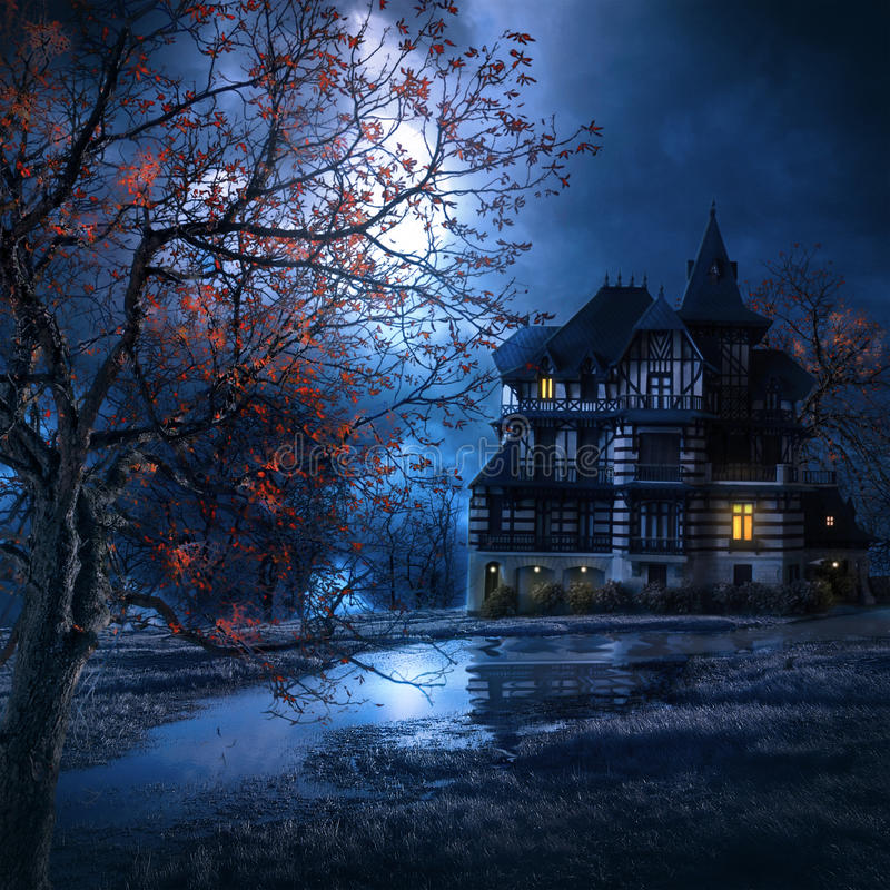 Macabre house in the night. Mysterious house in the night with the moon illuminating the scenery royalty free stock photography