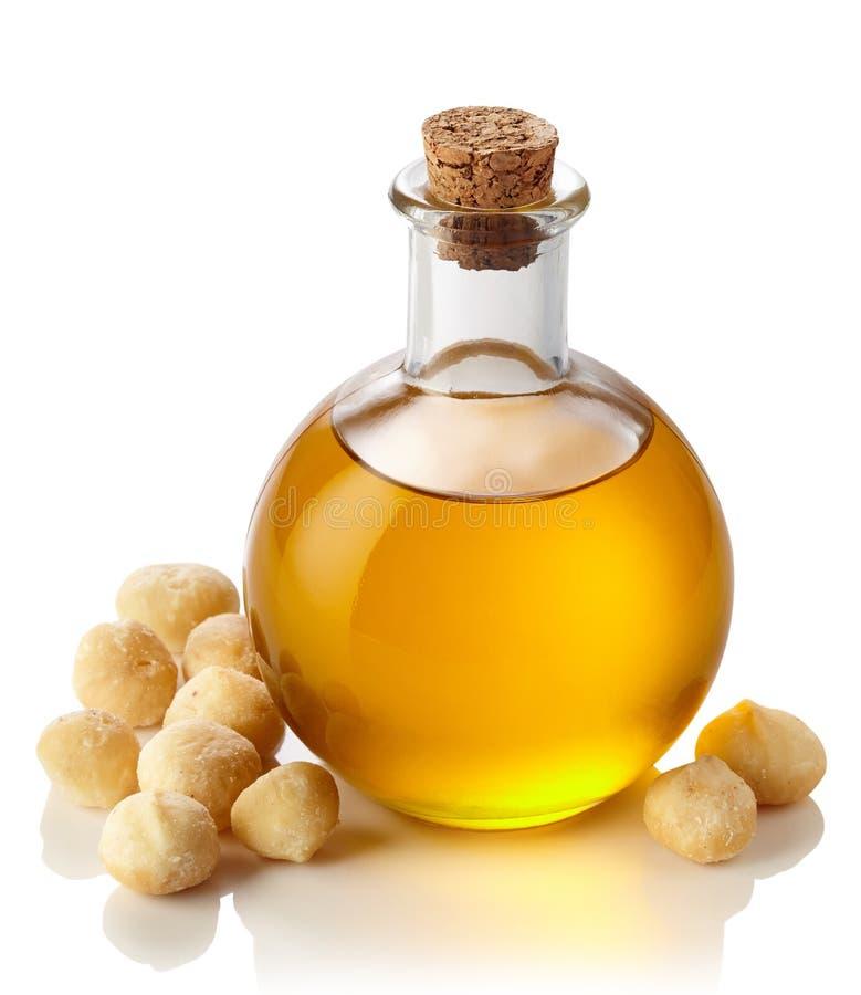 Macadamia πετρέλαιο καρυδιών στοκ εικόνες με δικαίωμα ελεύθερης χρήσης
